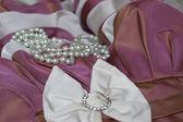 Pearl jewelry and elegant dress — Stock Photo