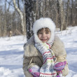Little girl throws snow — Stock Photo