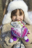 Little girl holding snow — Stock Photo