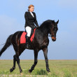 Woman on a horse — Stock Photo #27857915