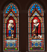 Catholic stained glass window from a church. — Stock Photo