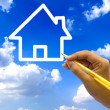 Hand drawing house icon on blue sky. — Stockfoto