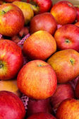 Yummy pile of apples in a market stall. — Stock Photo