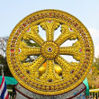 Stock Photo: Wheel of dhamma of buddhism.