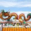Stock Photo: Colorful dragon statue on chintemple roof.