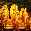 Stock Photo: Golden buddhstatue in Chinese temple in Thailand