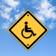 Handicap disabled sign on beautiful sky background. — Stock Photo