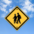 School warning sign on yellow with a blue sky background — Stock Photo #27441373
