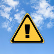 Warning sign on beautiful sky background. — Stock Photo