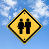 Man and women sign on beautiful sky background. — Stock Photo