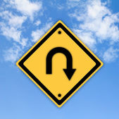 Turn back road sign on beautiful sky background. — Stock Photo