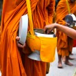 Offer food to monk on early morning — Stock Photo