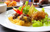 Thai food, rice in cold water served with fried sweet pork,fried — Stock Photo