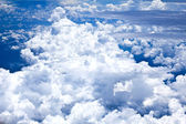 Blue sky and Clouds looking from the Airplane — Stock Photo