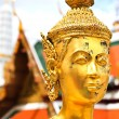 Golden kinnara statue in Grand palace Bangkok,Thailand. — Stock Photo #27694607