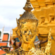 Golden kinnara statue in Grand palace Bangkok,Thailand. — Stock Photo #27694789