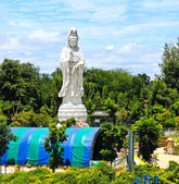 White marble statue of Buddha in the river Kwai valley — Stock Photo
