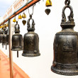 Temple bells hanged for everyone to ringed them for their own fo — Stock Photo