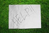 纸上绿草字段的帮助 — 图库照片