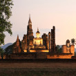 Ancient buddha statue at twilight, Wat Mahathat in Sukhothai His — Foto Stock