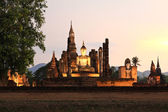 Ancient buddha statue at twilight, Wat Mahathat in Sukhothai His — Stock Photo