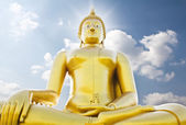 Big golden buddha statue against sky — Stock Photo