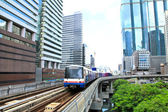 Sky train in Bangkok with business building — Stock Photo