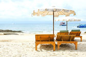Beach chairs on tropical white sand beach — Stock Photo