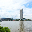 Buildings along the river. The view from Santi Chai Prakan Park. — ストック写真