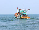 Wooden fishing boat on sea — Stock Photo
