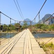 Bridge over Song River, Vang Vieng, Laos. — Stock Photo #41172937