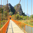 Stock Photo: Bridge over Song River, Vang Vieng, Laos.