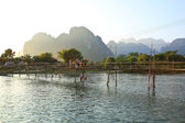 VANG VIENG, LAOS - FEB 1: Local people and tourists cross the ba — Stock Photo