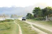 VANG VIENG, LAOS - FEB 1: Local car on a rural road on February  — Stock Photo