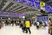 BANGKOK- AUGUST 15 : Passengers walking in Suvanaphumi Airport, — Stock Photo