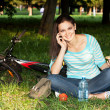 Woman relaxing in the park on the lawn — Foto Stock