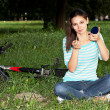 Stock Photo: Woman relaxing in the park on the lawn