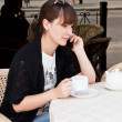 Stock Photo: Beautiful girl in a cafe