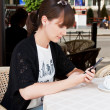 Beautiful girl in a cafe — 图库照片