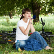 Girl has a rest on a lawn in park — Stock Photo
