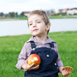 Boy eats in the park — Stock Photo