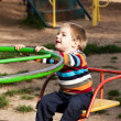 Boy riding on a swing — Stock Photo