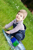 Boy playing on the lawn — Stock Photo