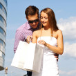 Girl shows her boyfriend to buy — Stock Photo