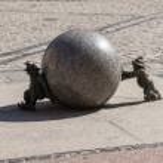 Stone dwarfs pushing the ball. — Stock Photo #29059883