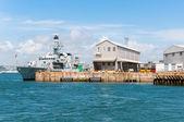 Battleship in harbor — Stock Photo