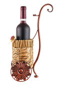 Bottle of red wine in wheeled basket — Stock Photo