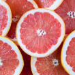 Background of red grapefruit slices — Stock Photo #40006381