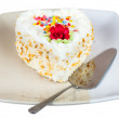 Cake in the shape of heart on plate — Stock Photo