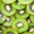 Background of kiwi slices — Stock Photo